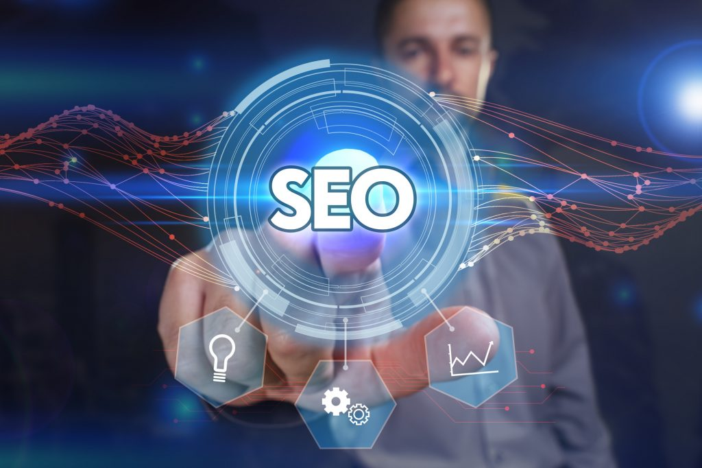 Business, Technology, Internet and network concept. Young business man chooses the virtual screen: SEO basics